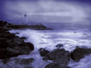 обои Домики и маяк на берегу моря фото