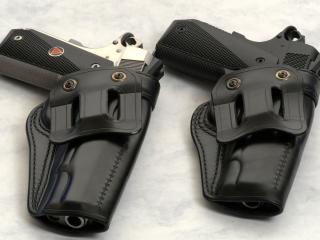 обои Два пистолета в кобуре фото