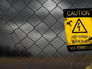 обои Предупреждающий знак на железной сетке фото