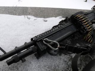 обои Черный пулемет с лентой фото