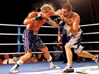 обои Боксерский двобой на ринге фото