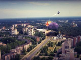обои Самолет сбросил бомбу над городом фото