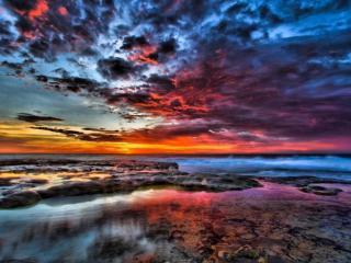 обои Разноцветный закат на море фото