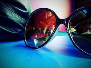 обои Отражение в очках ее и его фото