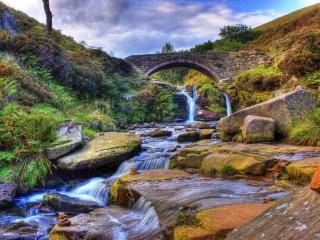 обои Арочное перекрытие над небольшим водопадом фото