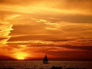 обои Красный закат и парусник на морe фото