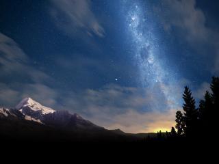 обои Млечный путь над горными вершинами фото