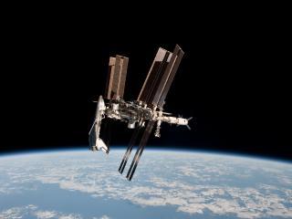 обои Станция в пространстве над землей фото