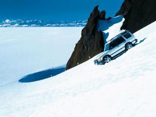 обои Land Rover спускается с вершины фото