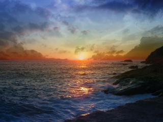 обои Закат на море и каменистый берег фото