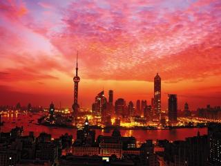 обои Яркий розовый закат над местностью городской фото