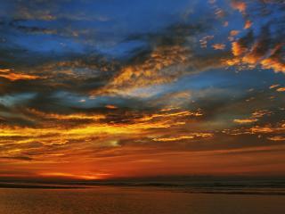 обои Вид неба над океаном на закате солнца фото