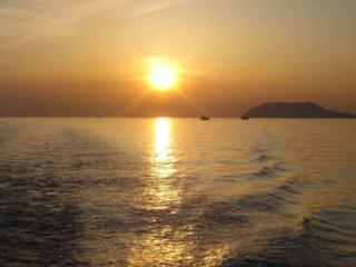 обои Над морем закат фото