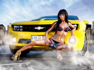 обои Девушка у фары желтой машины фото