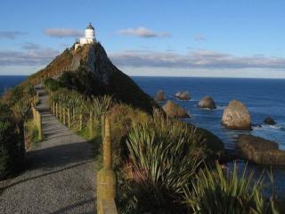 обои Маяк Наггет Поинт в Новой Зеландии фото