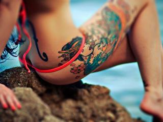 обои Красивые татуировки на ноге девушки фото
