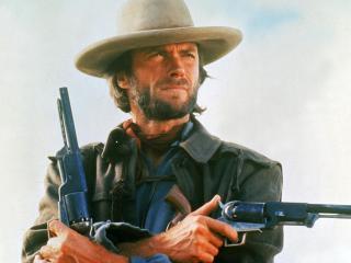 обои ковбой с револьверами в рyках фото