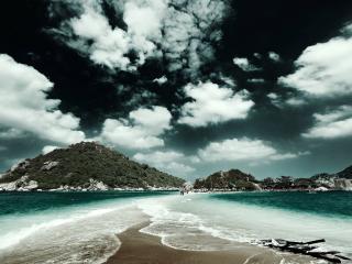 обои Белые облака на темном небе над островами фото