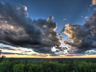 обои Большие облака серые на закате фото