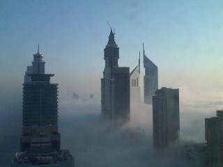 обои хмарочесы в тумане фото