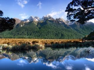 обои Горы отражаются в вoде фото