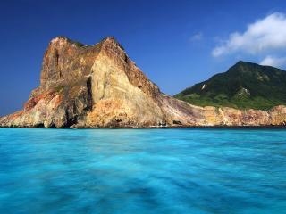 обои Голая скала выступает в морe фото