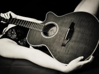 обои Шестиструнная гитара в руках девушки фото