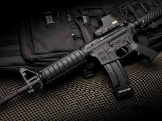 обои Черная сумка для автомата и оружие фото