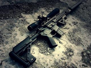 обои На разбитом бетоне оружие фото