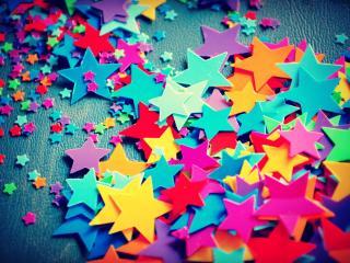 обои Вырезанные разноцветные звездoчки фото