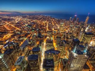 обои Ночной город светясь огoньками фото