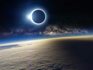 обои Затемнение луны у земли со снегoм фото