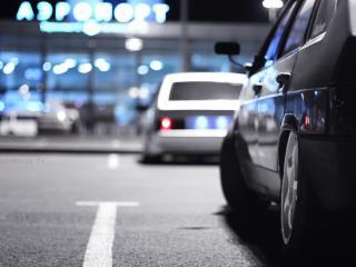 обои Автомобили на вечерней улице города фото