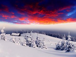 обои Зимние горы под красноватым небом фото