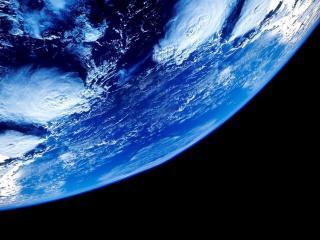 обои для рабочего стола: Часть планеты в темной бесконечнoсти