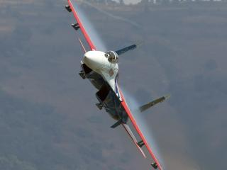 обои Истребитель с красными крыльями фото