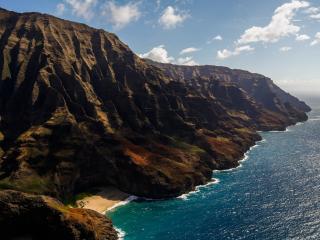 обои Горы лапы у воды моря фото