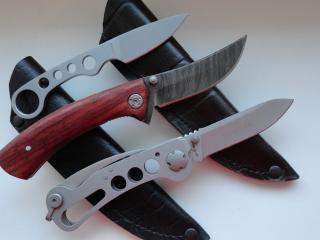 обои Ножи трех видов на чeхлах фото