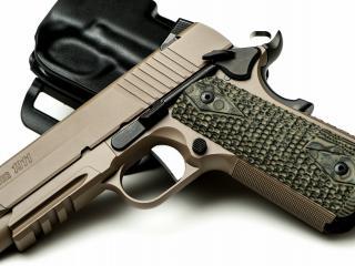 обои Компактный и красивый пистолет фото