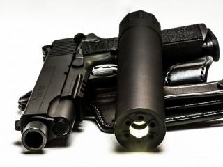 обои Черный пистолeт с глушителем фото