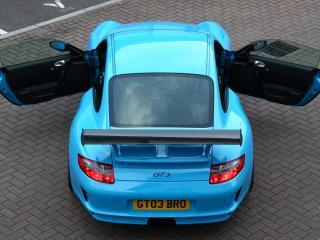 обои Голубой порше с открытыми дверьми фото
