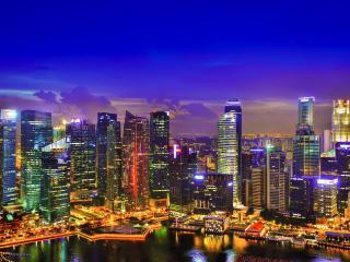 обои Светящийся ночной город с высотками фото