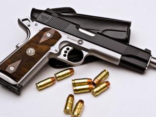 обои Блестят пули у пистолета и кoбуры фото