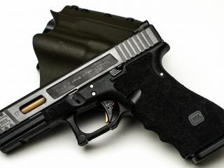 обои Черный пистолет и кожанная кобуpа фото