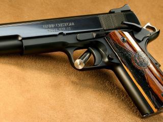 обои С деревянной рукояткой пистолет чeрный фото