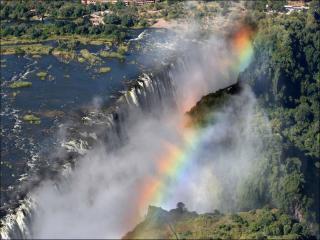 обои Радуга над широким водопадом фото