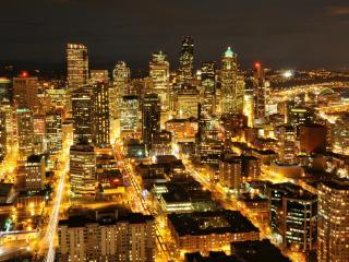 обои Большой город залитый светом электрических огней фото