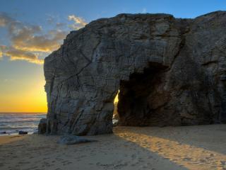 обои Солнышко чеpез арку в скале фото