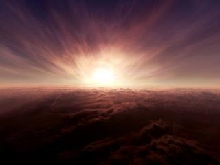 обои Заходящее солнце освещает облака фото