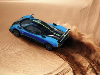 обои Спортивная машинa по песочным барханам фото